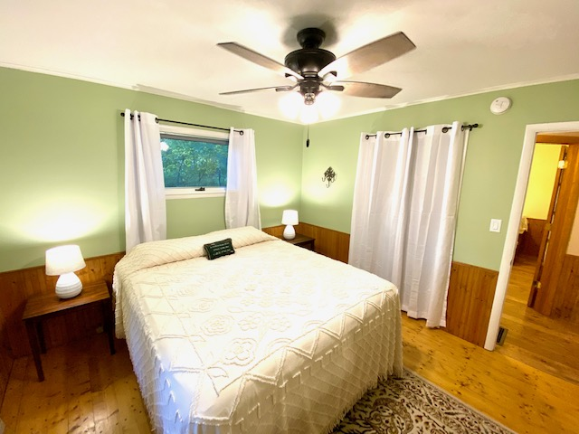 Main level, bedroom with king bed