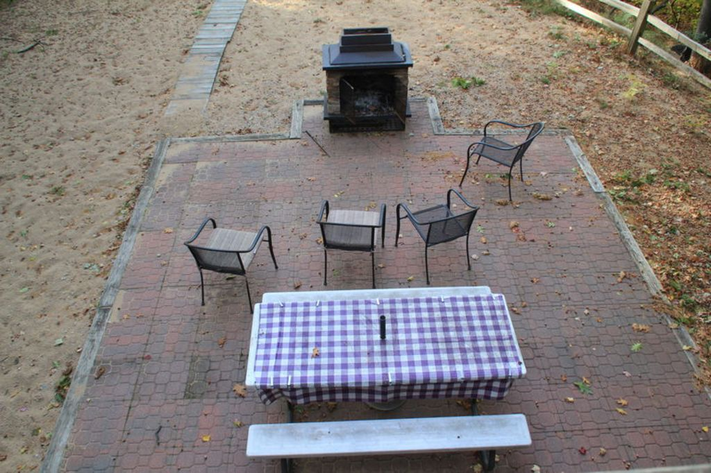 Lower level, patio with outdoor seating and grill