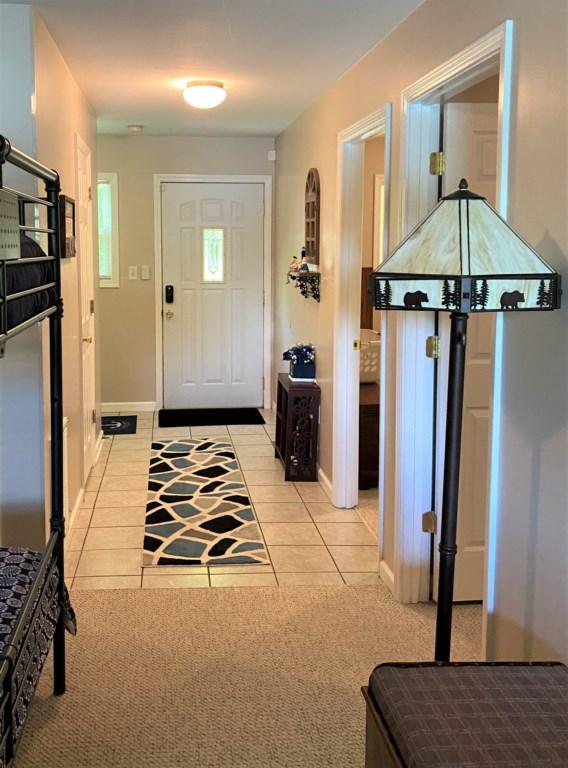 Hallway (View from open area bedroom to front door.)