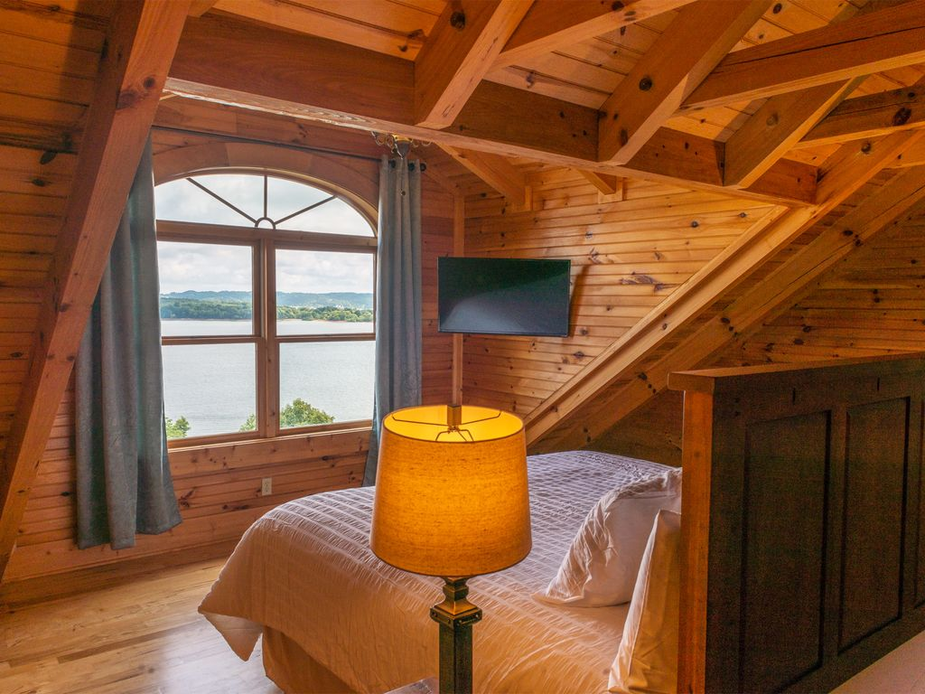Guest Suite #3 with breathtaking views of Douglas lake equipped with King sized bed and 40 inch TV. With Private bath
