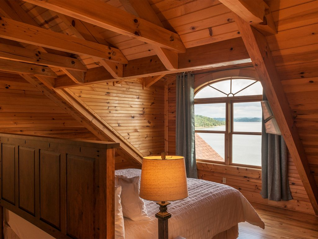 Guest Suite #2 with breathtaking views of Douglas lake equipped with King sized bed and 40 inch TV. With Private bath