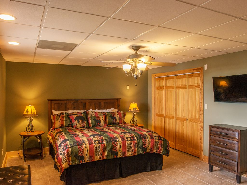 Jaw dropping views from downstairs guest bedroom #4 equipped with a luxurious king size bed and 40 i