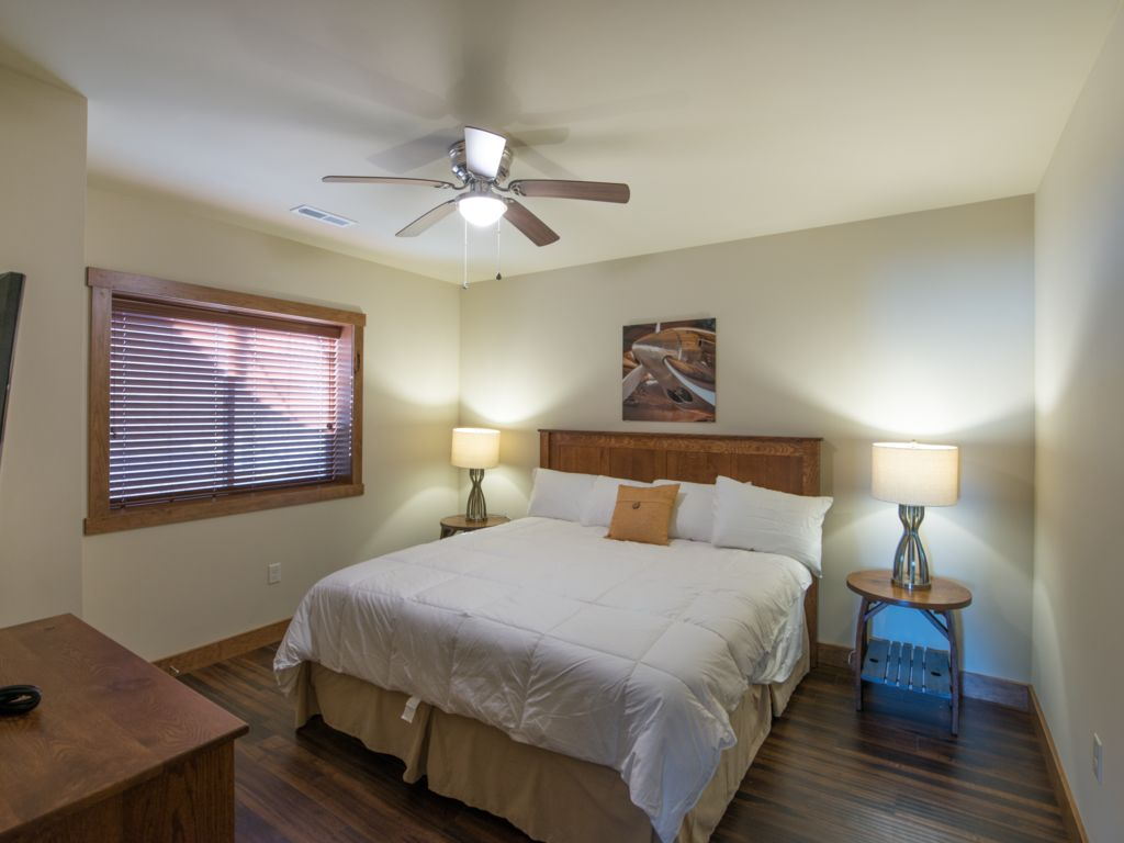 Guest room#3 featuring king size bed with 40 inch TV and luxury bedding. Located on basement level.