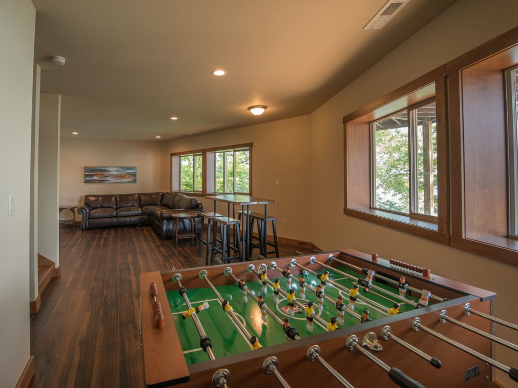 Enjoy a game of Foosball while watching sports on your 60 inch TV in your downstairs Living Room