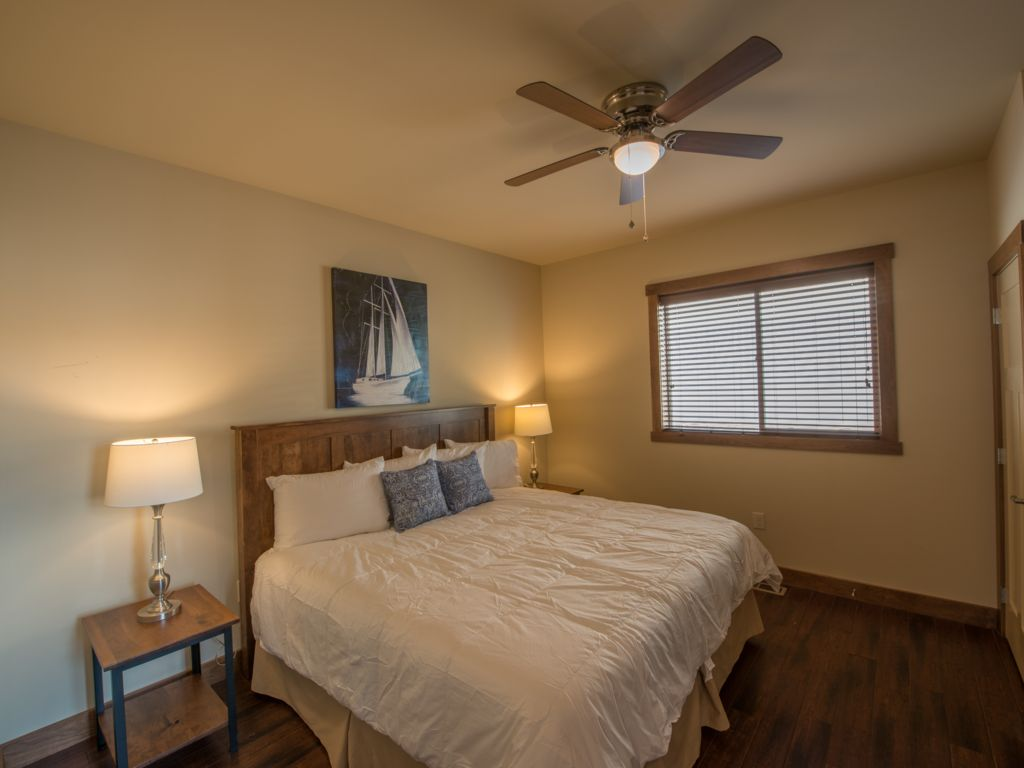 Master suite #2 featuring a king size bed and 40 inch TV with luxury bedding. Equipped with Custom made Amish furniture
