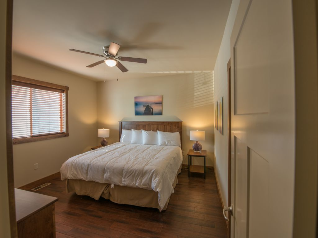 Guest room#2 featuring king size bed with 40 inch TV and luxury bedding. Located on main level.