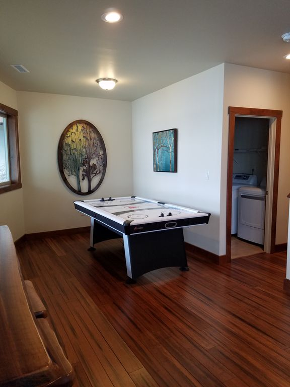 Unwind in your open family great room featuring a 60 inch TV, Air Hockey, and panoramic views from every window.