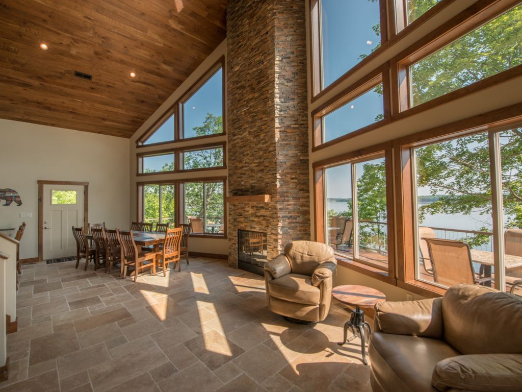 Your charming Great Room with jaw dropping views of Douglas Lake.