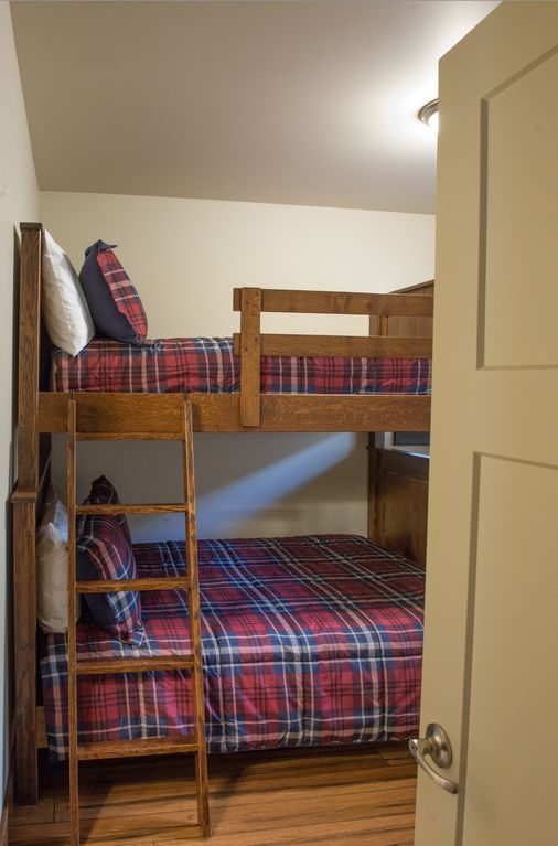 Guest bedroom #4 equipped with 1 twin over queen bunk beds and 40 inch TV.