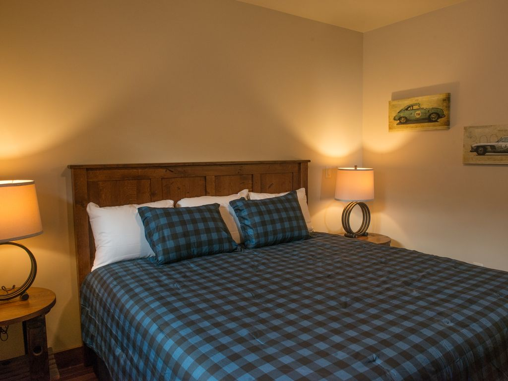Guest room #3 featuring king size bed with 40 inch TV and luxury bedding.  Equipped with custom made Amish Furniture