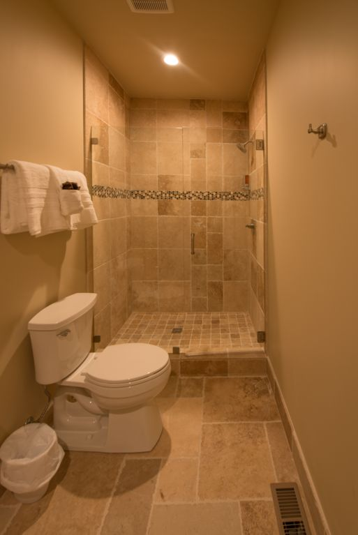 Jack and Jill for guest rooms on  basement level with custom built walk in shower.