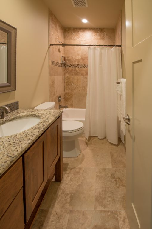 Basement full bath featuring a natural stone shower, or relax in the soaking tub