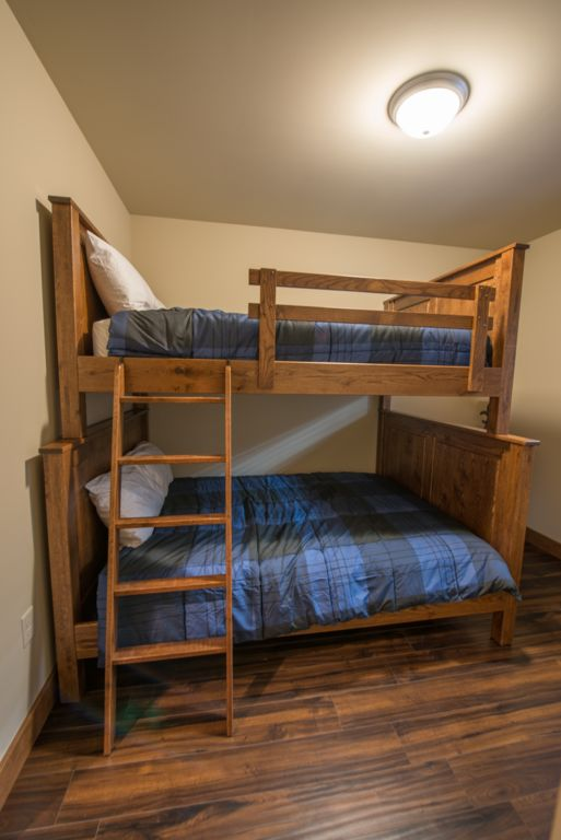 Guest room#2 featuring king size bed with 40 inch TV and luxury bedding. Equipped with Custom made Amish furniture