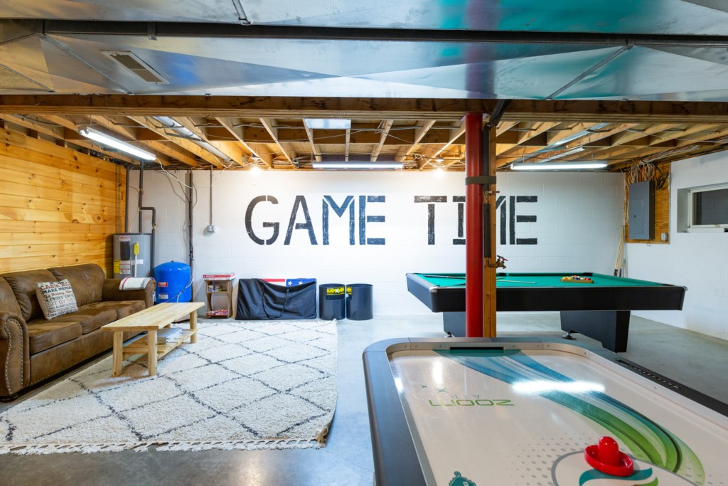 A game room equipped with air hockey and a pool table.
