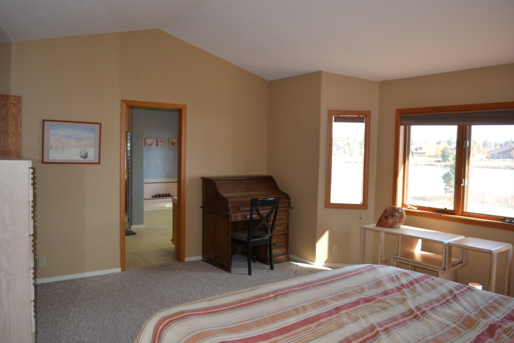 Master Bedroom with Bath, Dresser, and Desk Area