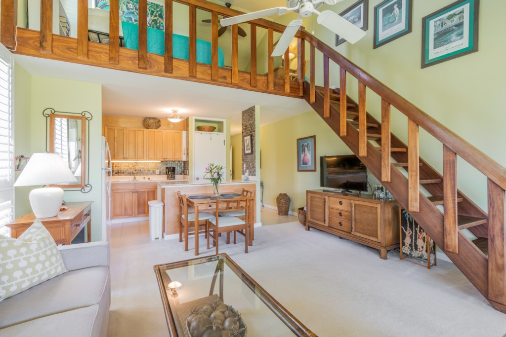 Living Room with Staircase to the Loft