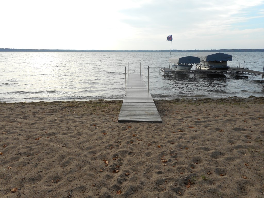 Beach front includes a private dock with an amazing sand beach.