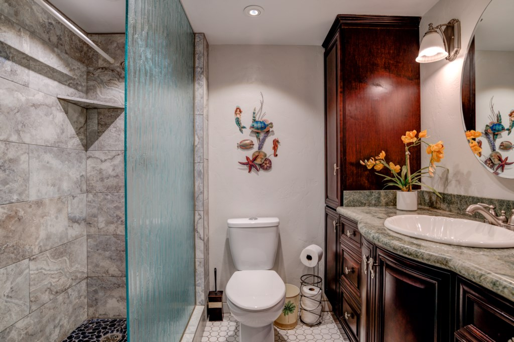 Beautifully remodeled. Large walk in shower with floor to ceiling glass door.