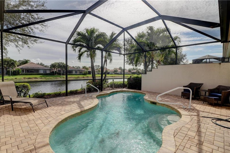 Relax and soak up the Florida sun in your Private Pool area with Lake view