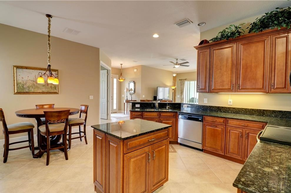 Spacious Kitchen with breakfast bar, granite counters, stainless appliances and pantry