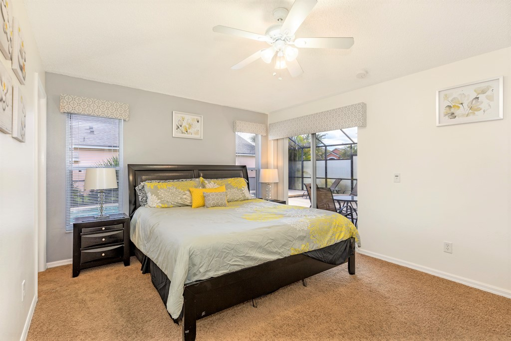 14. Master suite one with king bed, TV and ensuite bathroom.JPG