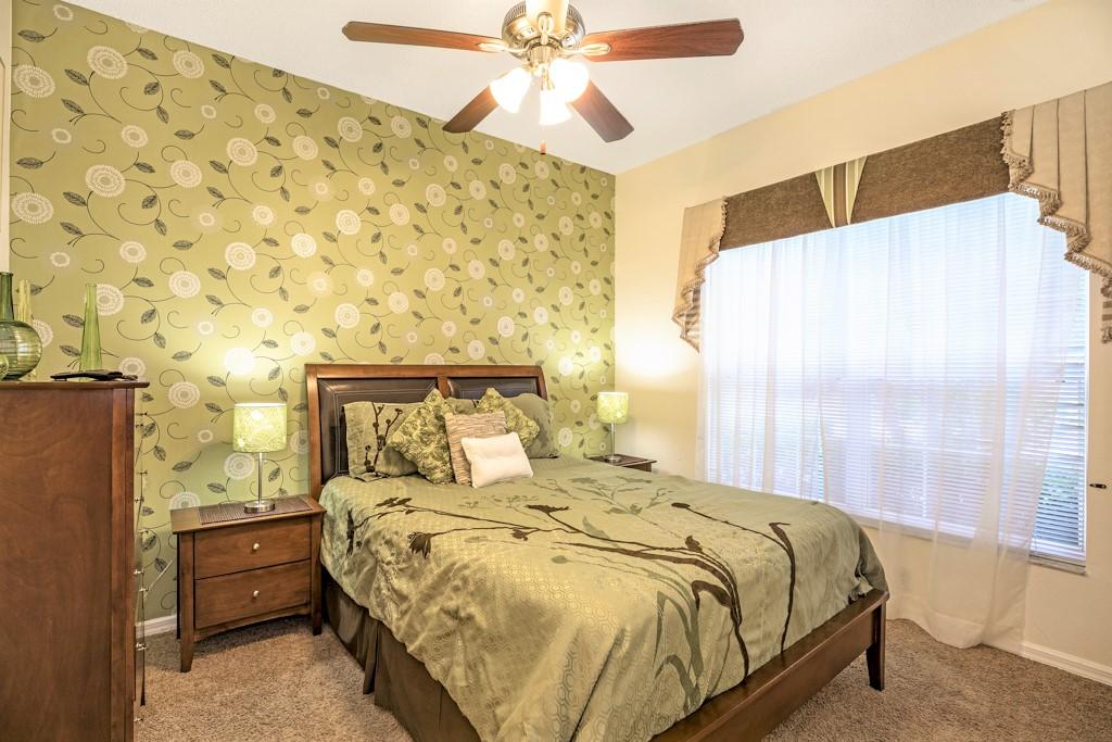 17. Master suite 2 with queen bed & TV.JPG