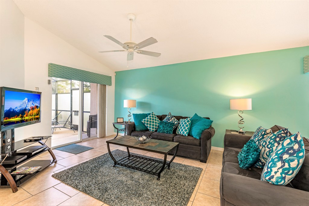 4a.Orlando villa with family lounge overlooking the pool deck.JPG