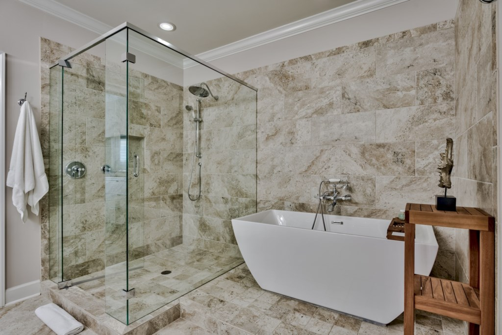 Spa like Master Bathroom with free standing tub and fully tiled