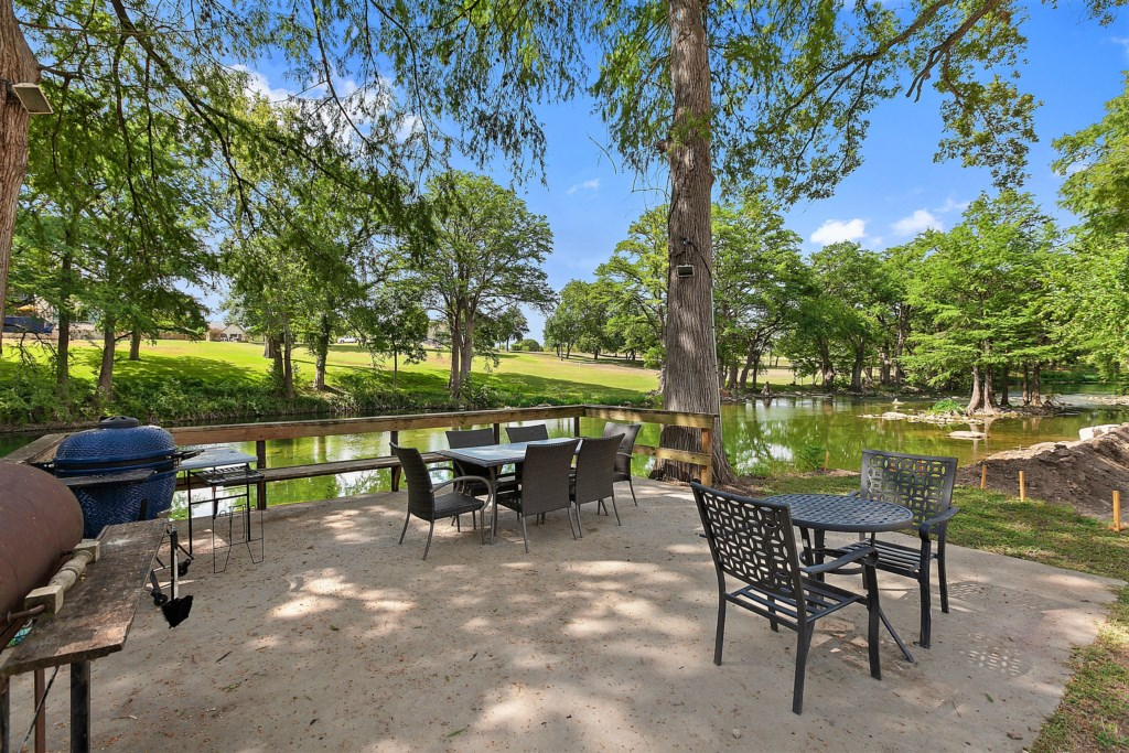 Beautiful outdoor, shared space with furniture and grill!