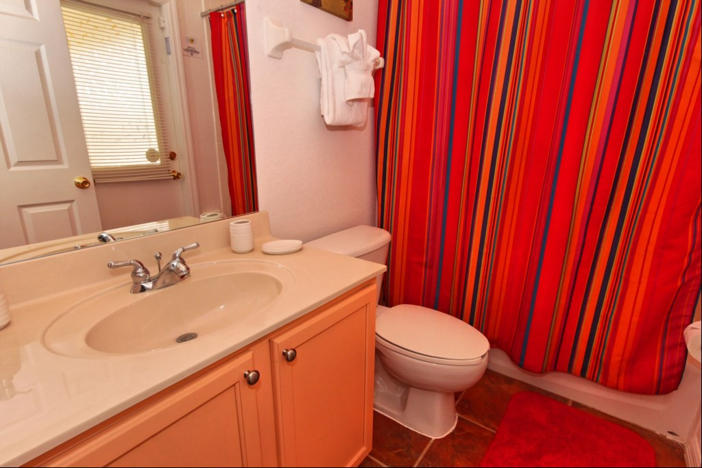 Bedroom 2 ensuite bathroom with direct access to pool deck
