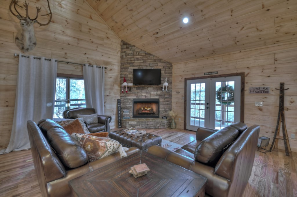 Spacious sitting Room with access to the deck bringing the outdoors in