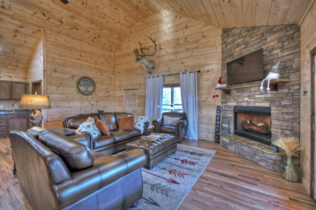 Enjoy cozy seating whilst you relax in front of the fireplace
