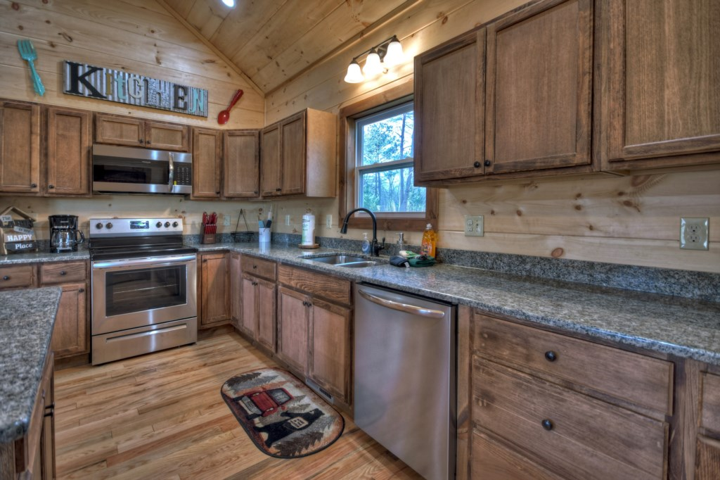 Cook up a meal in your Gourmet Kichen with Oak cabinets, granite counters and stainless appliances