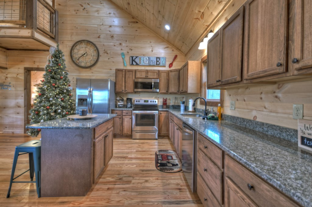 Spacious kitchen with pantry and island with seating