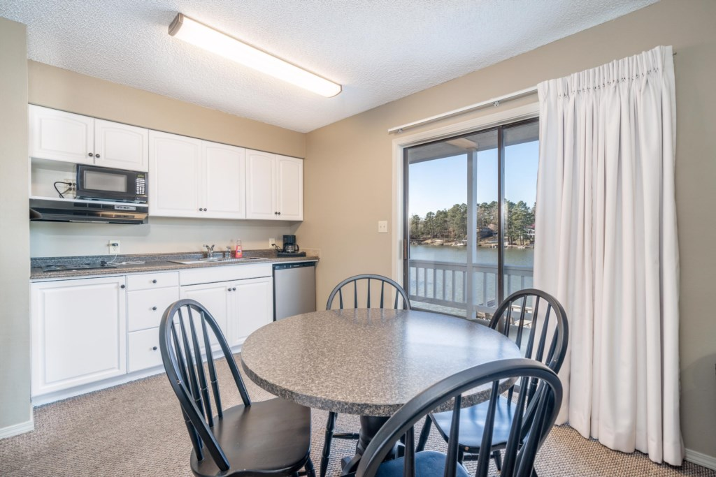 Kitchen with cooking basics, dining and Lake views