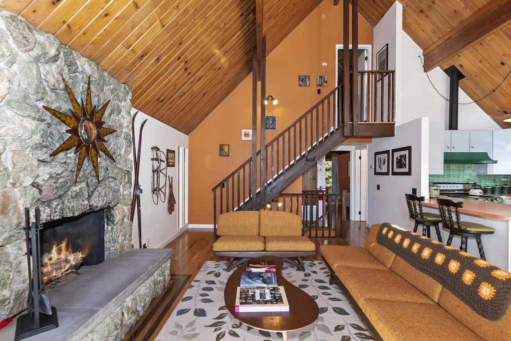 Living Room with stairs to Upper Level Master Bedroom and half bath