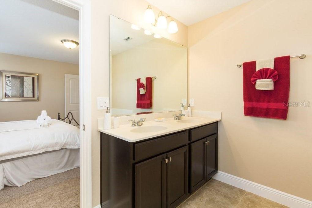 Bathroom 4 - En suite bathroom off Bedroom 4 (King). Double sinks, garden tub, walk in shower, toilet corner