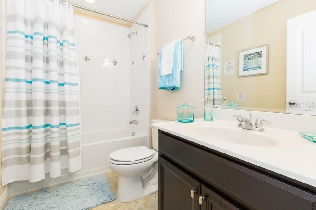 Bathroom 5- Hallway Bath near Bedroom 5 (twin room), shower/tub combo, toilet, single sink