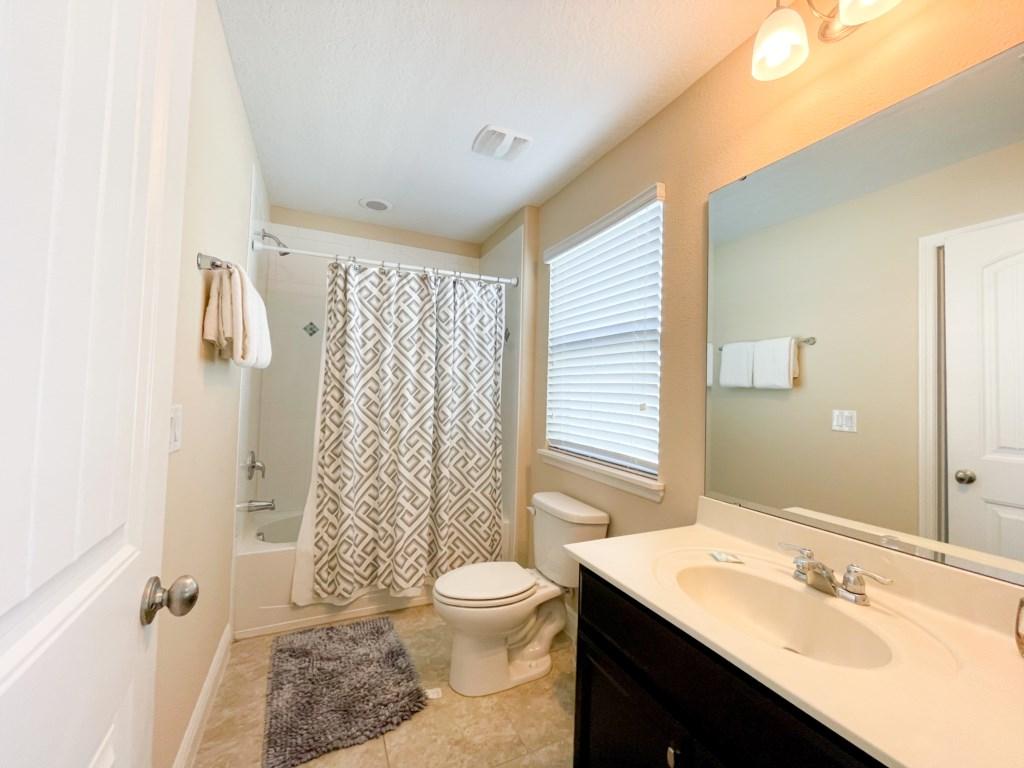 Bathroom 3- Jack n Jill bathroom shared between 2 queen rooms, shower/tub combo, toilet, single sink