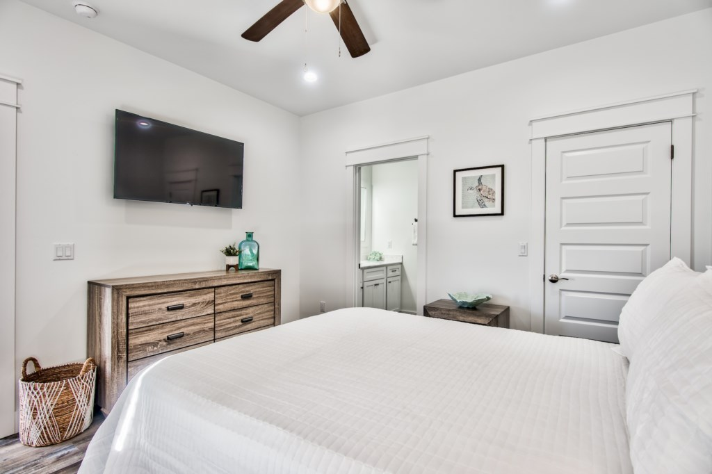 Queen Bedroom with storage and ceiling fan