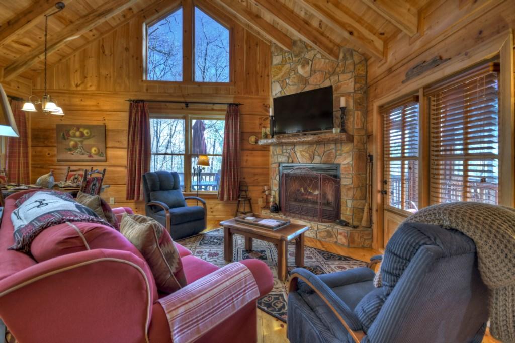 Open floor plan with stunning floor to ceiling rock fireplace