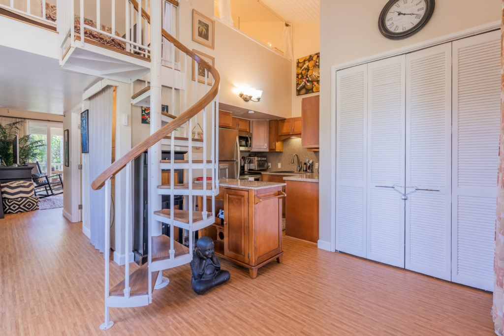 Kitchen w/Stairs Leading to Loft