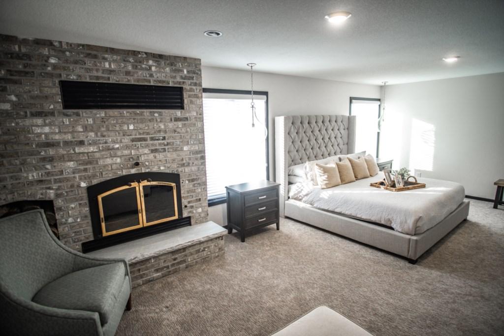 Fireplace in queen bedroom.