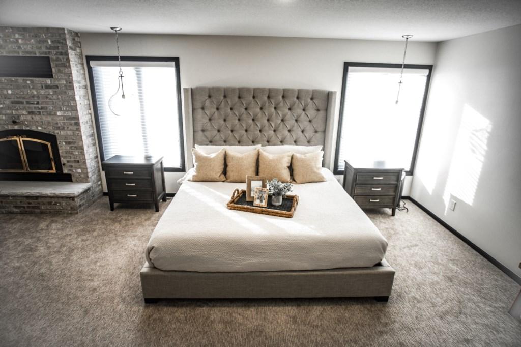 Bedroom 4 of 5:  Queen bedroom with seating area.