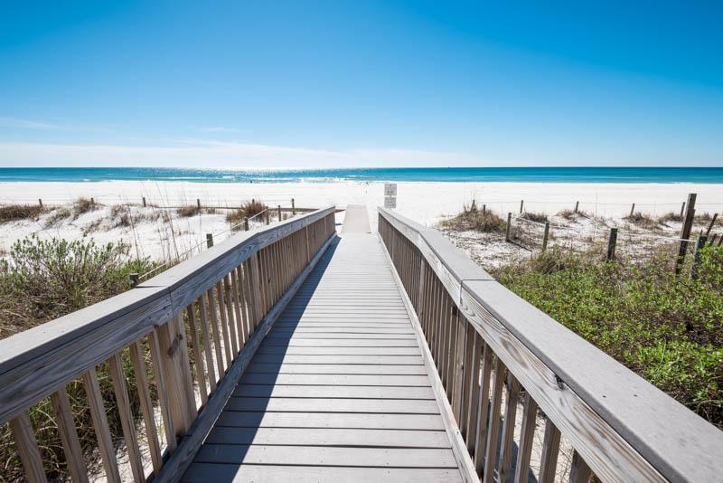 Boardwalk to the white sandy beach.