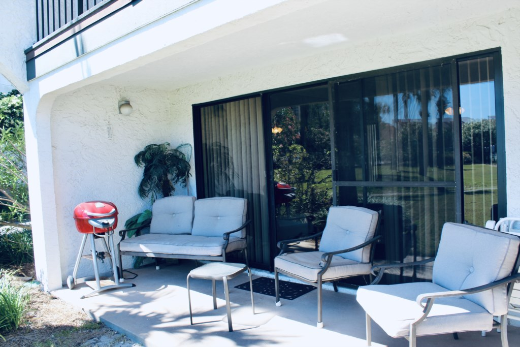 Patio has plenty of seating and offers an electric grill for cooking.