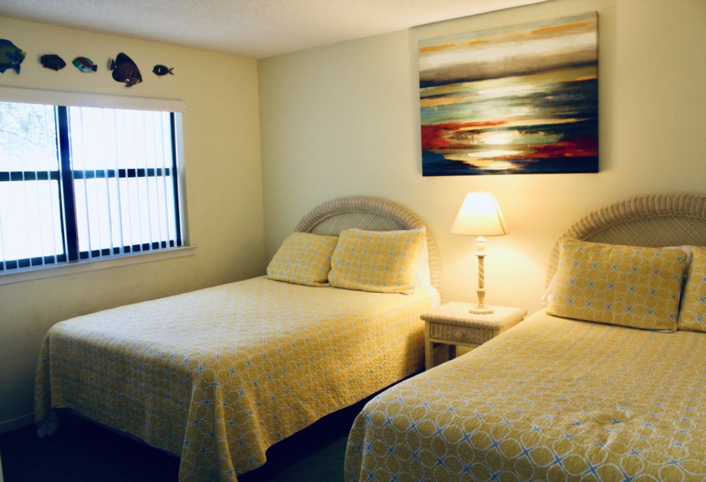 Bedroom 3 offers a full bed and queen bed.