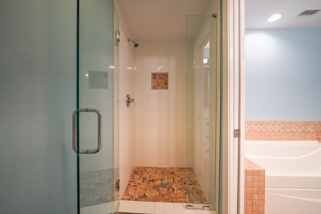 Private water closet with beautifully tiled stand alone shower