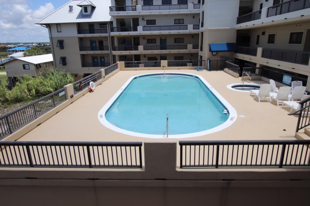 Large shared pool with hot tub, shared bathrooms, and out door shower