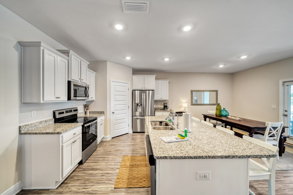 Stunning kitchen with stainless appliances and stone countertops
